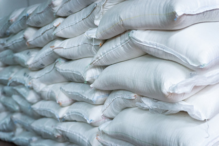 Stack of sugar or flour bags in warehouse. 스톡 콘텐츠