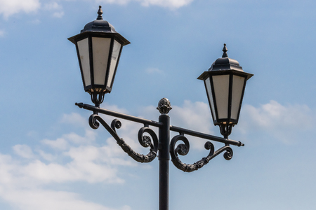 Vintage lamp post or street lantern. Blue sky background Stock Photo