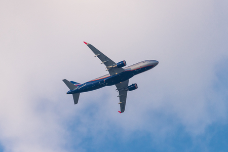 Russia, Rostovskaya oblast, Oktyabrsky: July 21, 2018: Aeroflot plane Airbus A320 in blue sky with white clouds.