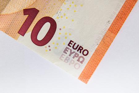 Ten Euro banknote fragment closeup on white background