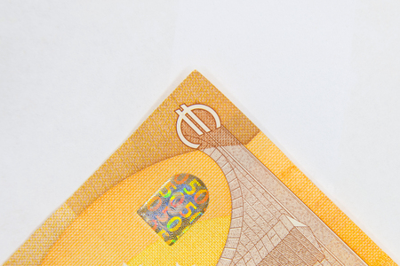 Fifty Euro banknote fragment closeup on white background