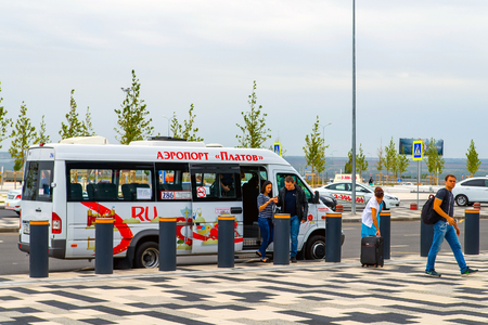 Rostov-on-Don, Russia - September 11, 2018: Passengers leave the shuttle at bus stop at the airport Platov.