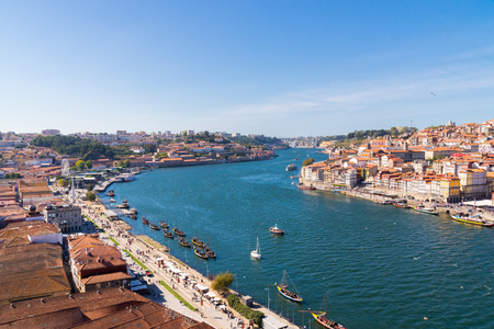 Porto, Portugal old town ribeira aerial promenade view with colorful houses, Douro river, panoramic view.