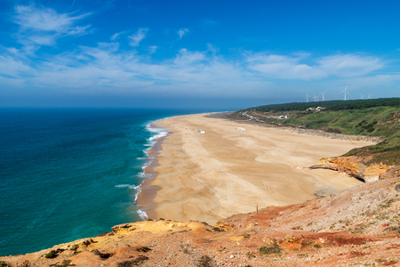 Scenic view of surf beach and ocean near Nazare Portugal.