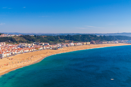 From the high point of the Nazare we can see the beach the sea and the village Nazare, Portugal.