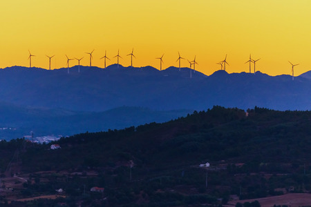 Wind Turbines High Hill Green Energy Generate Power Sunset. 免版税图像