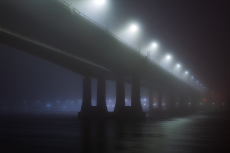 Bridge in the fog or mist by night. Stock fotó