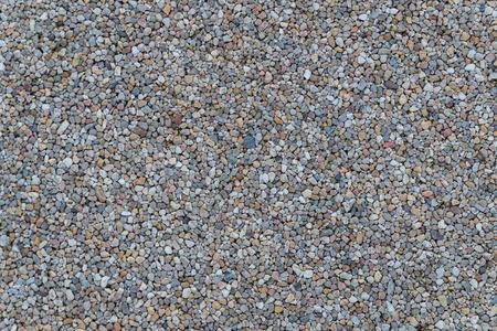 Texture de surface de motif de sol en pierres de gravier de granit blanc. Gros plan sur un matériau naturel extérieur pour le fond de décoration design.