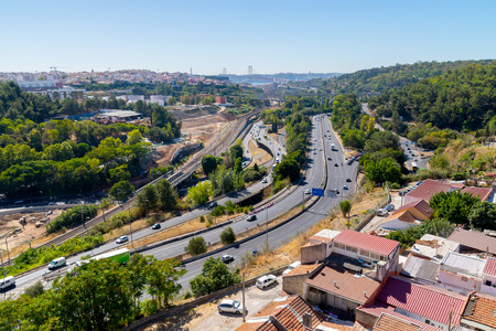 Panoramic view on Lisbon. Travel Portugal. Roads and bridges in big european city.