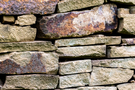 pattern gray color of modern style design decorative uneven cracked real stone wall surface.