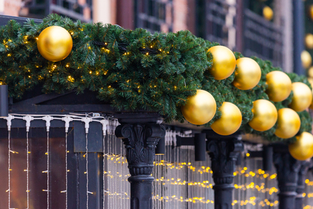 City christmas decoration. Christmas trees and balls on building.