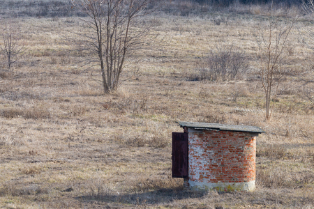 Small round lonely stone structure in the steppe. Zdjęcie Seryjne