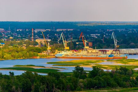 Cargo terminal and port cranes on the river.