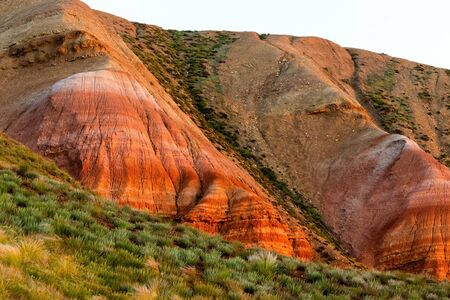 Big Bogdo mountain. Red sandstone outcrops on the slopes sacred mountain in Caspian steppe Bogdo - Baskunchak nature reserve, Astrakhan region, Russia Stock Photo