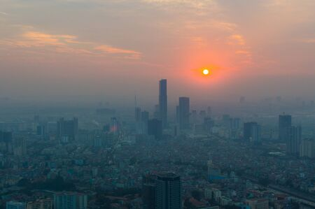 Aerial view of Hanoi skyline cityscape at sunset time.