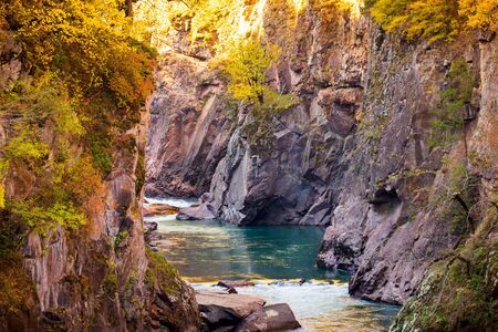 Fall landscape with mountain river and forest. Russia, Caucasus, Adygea