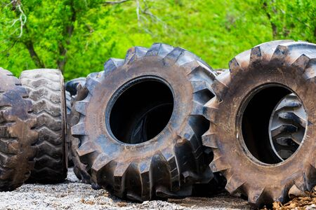Big tractor tires in outdoor in repair house.