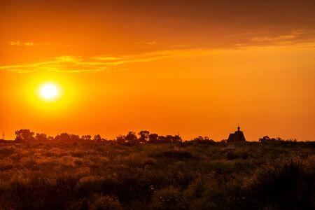 Sunset church cross silhouette in sunset sky clouds. Sunset church silhouette. Sunset sky clouds panorama Zdjęcie Seryjne