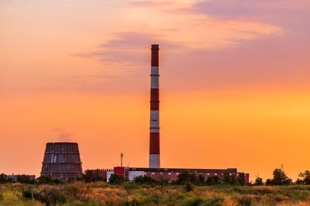 Thermal power stations during sunset. City power supply