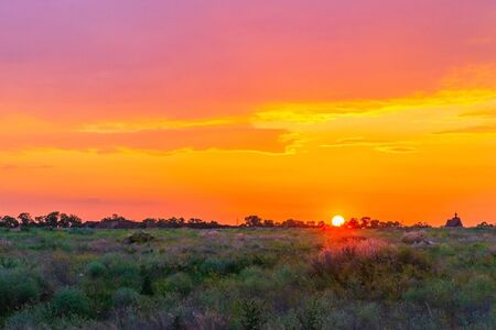 Sunset background, Panorama view with wonderful golden yellow sky, Amazing purple and orange sky in evening during the sun going down.