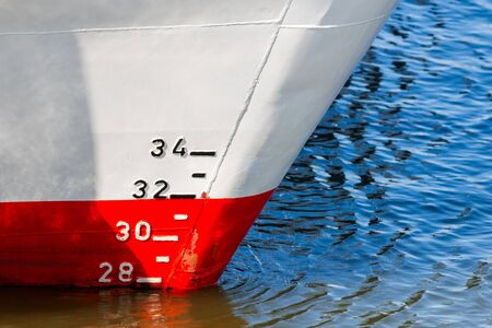 Red and white ship hull with waterline and draft scale measure. Reklamní fotografie