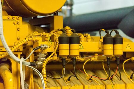Fragment of yellow industrial diesel engine for electrical generator in power station. 스톡 콘텐츠