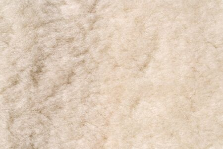 Dirty white warm wool texture background. Warm clothing material