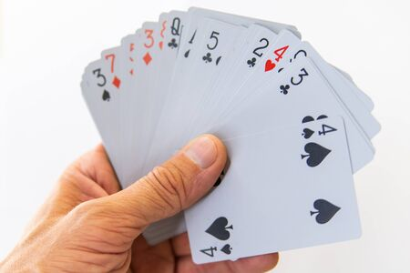 Playing cards in hand isolated on white background.
