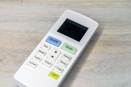 Air conditioner remote control with LCD display.