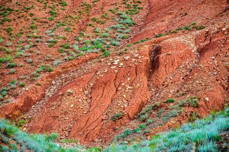 Big Bogdo mountain. Red sandstone outcrops on the slopes sacred mountain in Caspian steppe Bogdo - Baskunchak nature reserve, Astrakhan region, Russia