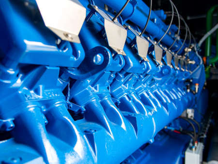 Engine of CHP unit. Diesel and gas industrial electric generator. Alternative energy for industry.