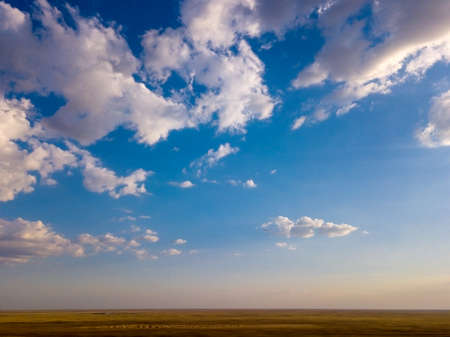 Blue sky and clouds with horizon on sunset.