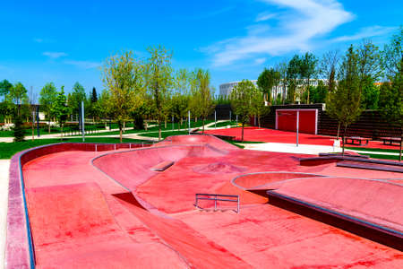 Red skate, roller and bike park with tubes, springboard and jumps.