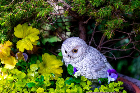 Garden decoration toy owl statue in the park.