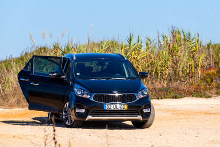 Portugal, Sao Lourenco, October 04, 2018: Black Kia Carens 2 ISG, five door MPV on open air with opened doors.