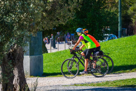 Portugal, Lisbon, October 09, 2018: Healthy lifestyle - people riding bicycles. City park for sports people.
