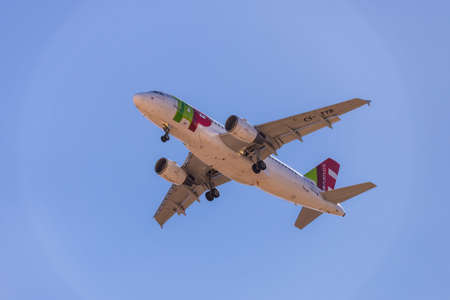 Portugal, Lisbon, October 09, 2018: Airplane of TAP PORTUGAL in blue sky. 新闻类图片