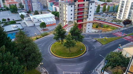 An aerial image of a traffic Island with circles around the outside.