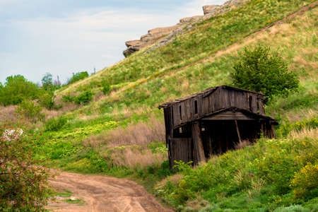 Abandoned and ruined wooden rustic barn in village. Zdjęcie Seryjne