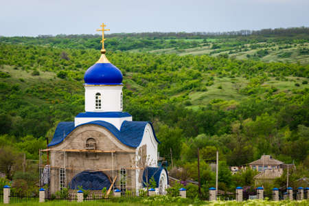 Blue dome of christian church with golden cross. Religious symbol of the Russian Orthodox Church. Zdjęcie Seryjne