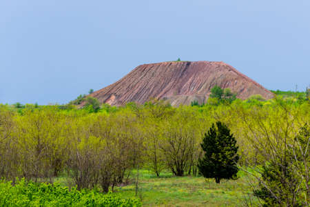View of slag heaps of iron ore quarry. Mining industry.