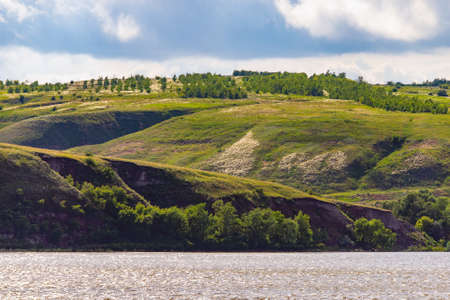 Panoramic view of the river Don and hills, slopes, steppe coast, gully, ravine on a banks. Zdjęcie Seryjne