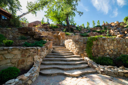Landscaping. Decorative stone steps down the hill.