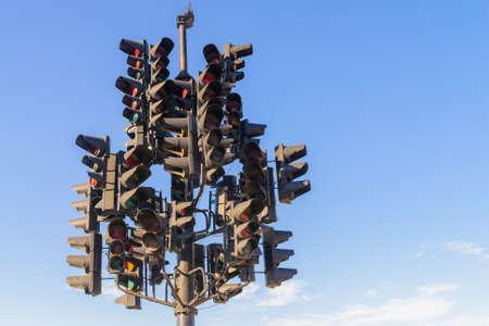 Many traffic lights in one. Blue sky on background. Zdjęcie Seryjne