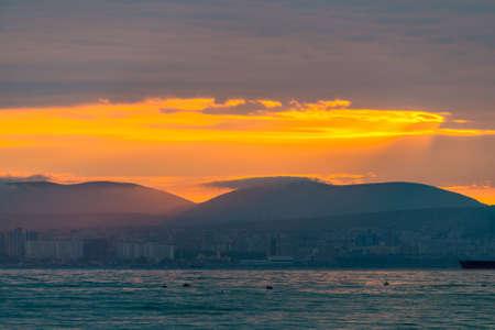City ona a coast of sea on sunset. Zdjęcie Seryjne