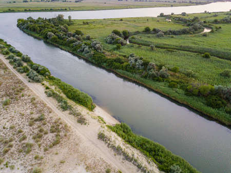 The junction of the river and canal with sandy shores. Zdjęcie Seryjne
