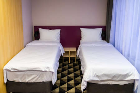 Hotel room with two double beds with pillows