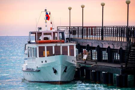 A beautiful sea boat moored near a pier. Zdjęcie Seryjne
