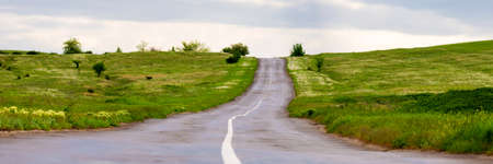 Empty old asphalt road with line in rural area.