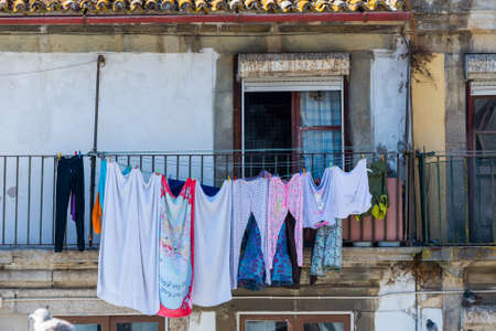 Clotheslines for dry clothes outside a windows in an old town.
